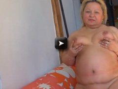 fat chubby lady is playing with her pussy