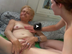 granny masturbates with young girl on bed